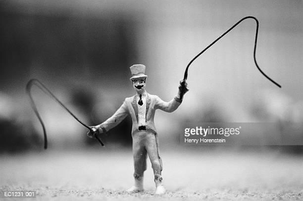 Toy circus ringmaster, close-up (B&W)