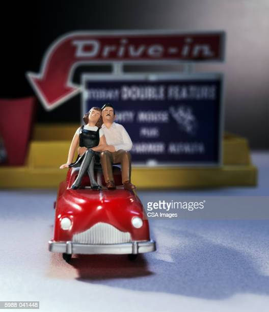 Toy Couple on Car at Drive-in