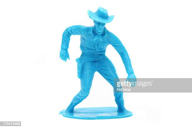 Toy cowboy about to draw pistol