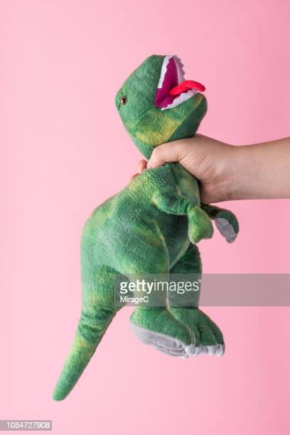 toy dinosaur - stuffed toy stock pictures, royalty-free photos & images