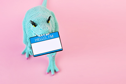 """Toy Dinosaur with """"Hello I'm"""" nametag - gettyimageskorea"""