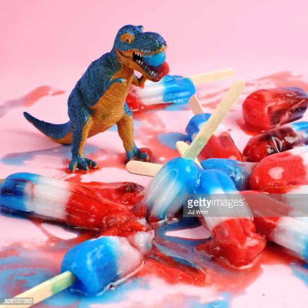 toy dinosaur with red white and blue ice pops - t rex stock photos and pictures