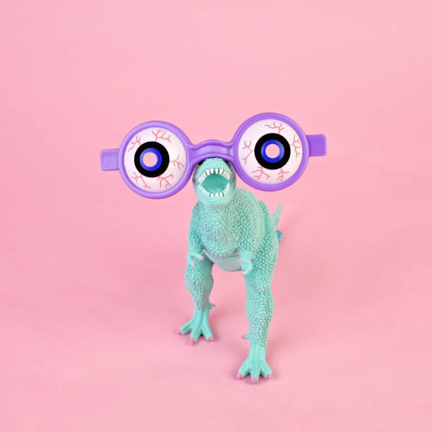 Toy dinosaur with spooky glasses