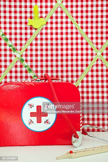 Toy doctor's bag in front of homemade memo board, Munich, Bavaria, Germany