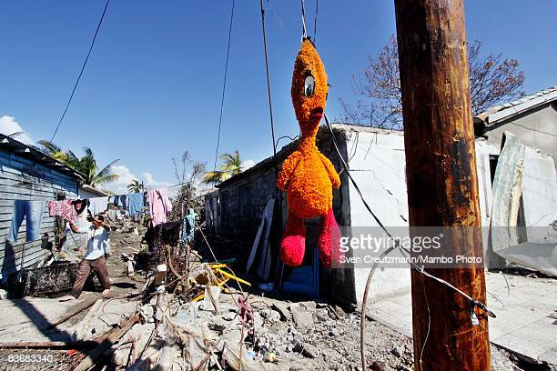 Toy duck hangs from a post between houses that were destroyed by Hurricane Paloma, November 12, 2008 in Santa Cruz del Sur, Cuba. Hurricane Paloma...