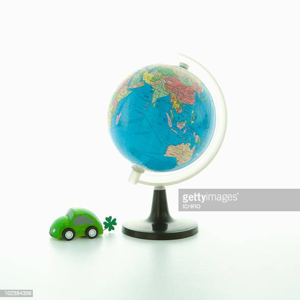 Toy eco car and a globe.