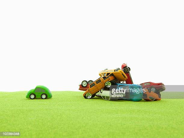 toy electric vehicle and old cars. - green car crash stock pictures, royalty-free photos & images