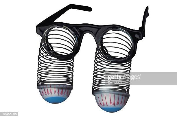 Toy eyeglasses with eyeballs on springs