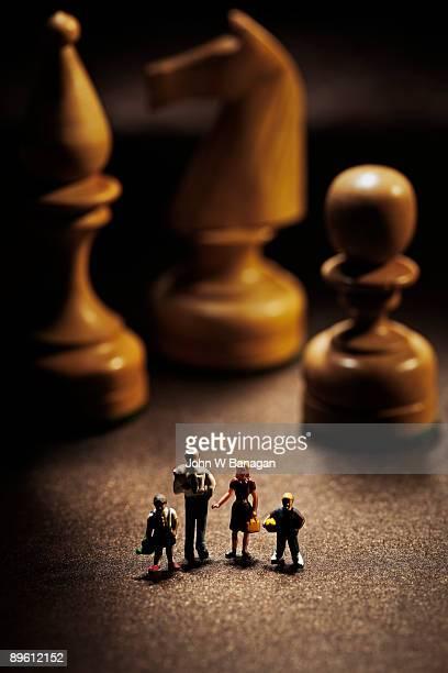 toy family with chess  pieces - oggetti femminili foto e immagini stock