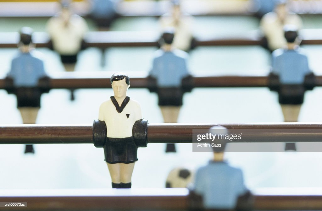 Toy figurine and football pitch : Stock Photo