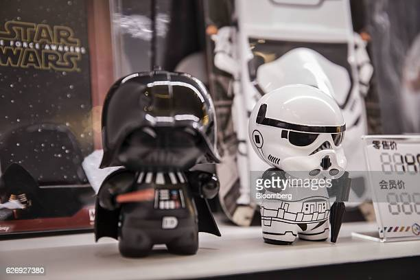 Toy figurines of Darth Vader and a Stormtrooper character from the 'Star Wars' film franchise are displayed at an Mtimecom Inc kiosk in Beijing China...