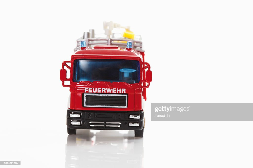 Toy fire truck on white background : Stock Photo
