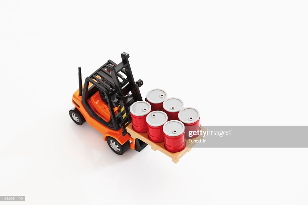 Toy forklift truck carrying barrels on white background, elevated view : Stock Photo