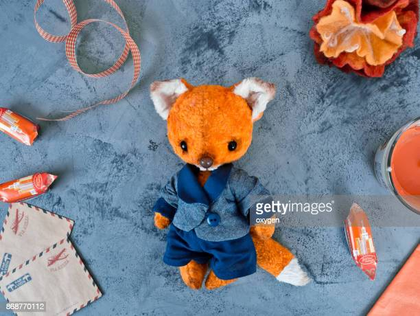 Toy fox Flat Lay on blue marble table