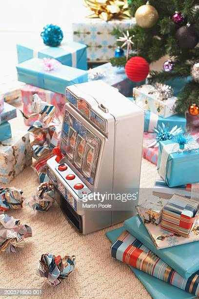 Toy fruit machine surrounded by gifts, elevated view