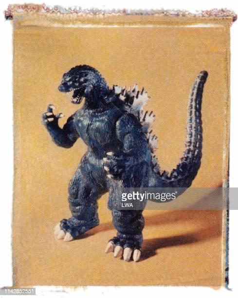 toy godzilla figurine - godzilla stock photos and pictures
