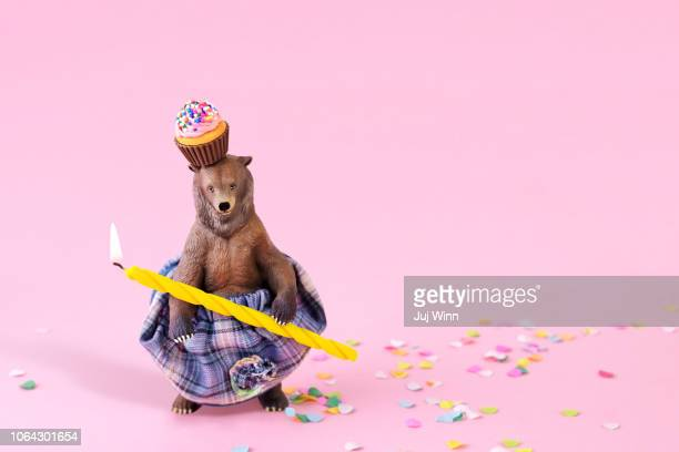 Toy grizzly bear in a skirt at a party