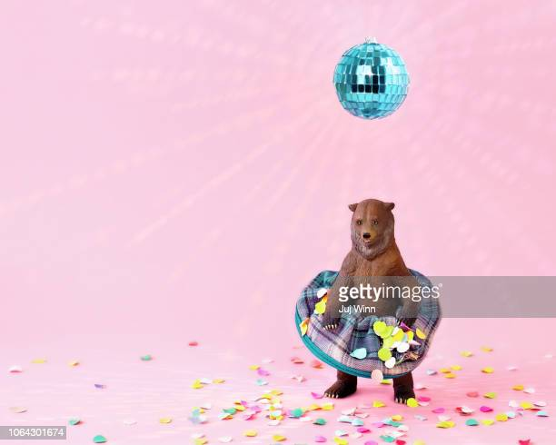 toy grizzly bear in a skirt at a party - blue bear stock photos and pictures