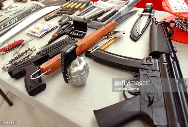 Toy guns knives and other assorted property are displayed during a press conference at John F Kennedy airport August 27 2003 in New York City The TSA...