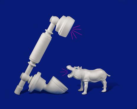 Toy hippopotamus talking on telephone - gettyimageskorea