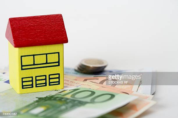 Toy house on Euro banknotes