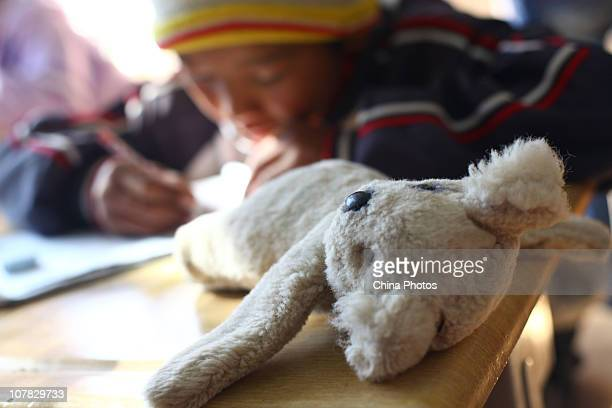A toy is placed on the desk of a student at the Lijiang Ethnic Orphan School on December 24 2010 in Lijiang of Yunnan Province China The Lijiang...