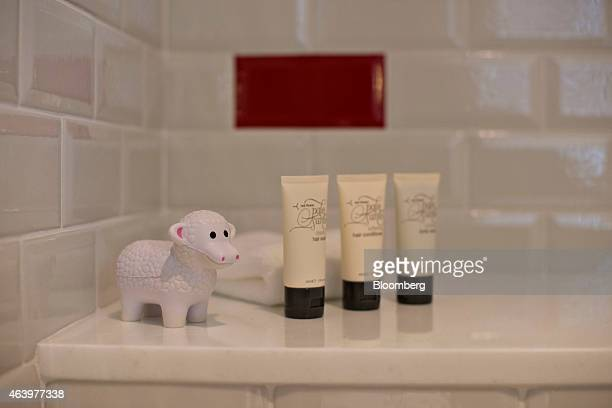 A toy lamb sits alongside toiletries inside a guest suite shower at the Virgin Hotels Chicago in Chicago Illinois US on Friday Feb 20 2015 The...