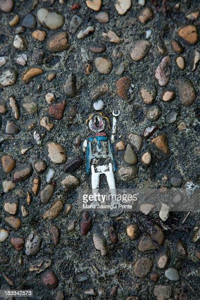 toy lodged in cement - roadkill stock photos and pictures