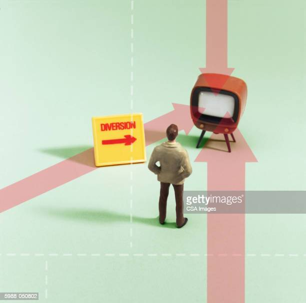 Toy Man Looking at Television