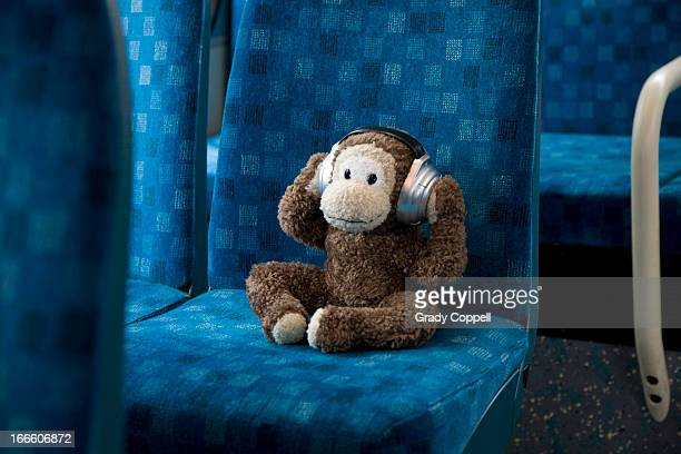 Toy monkey sitting on bus