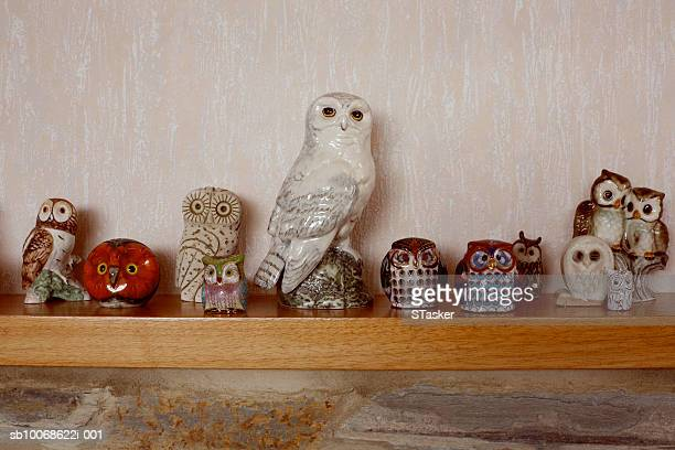 Toy owls on sideboard