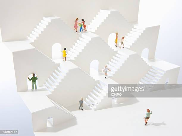 Toy people are on white steps