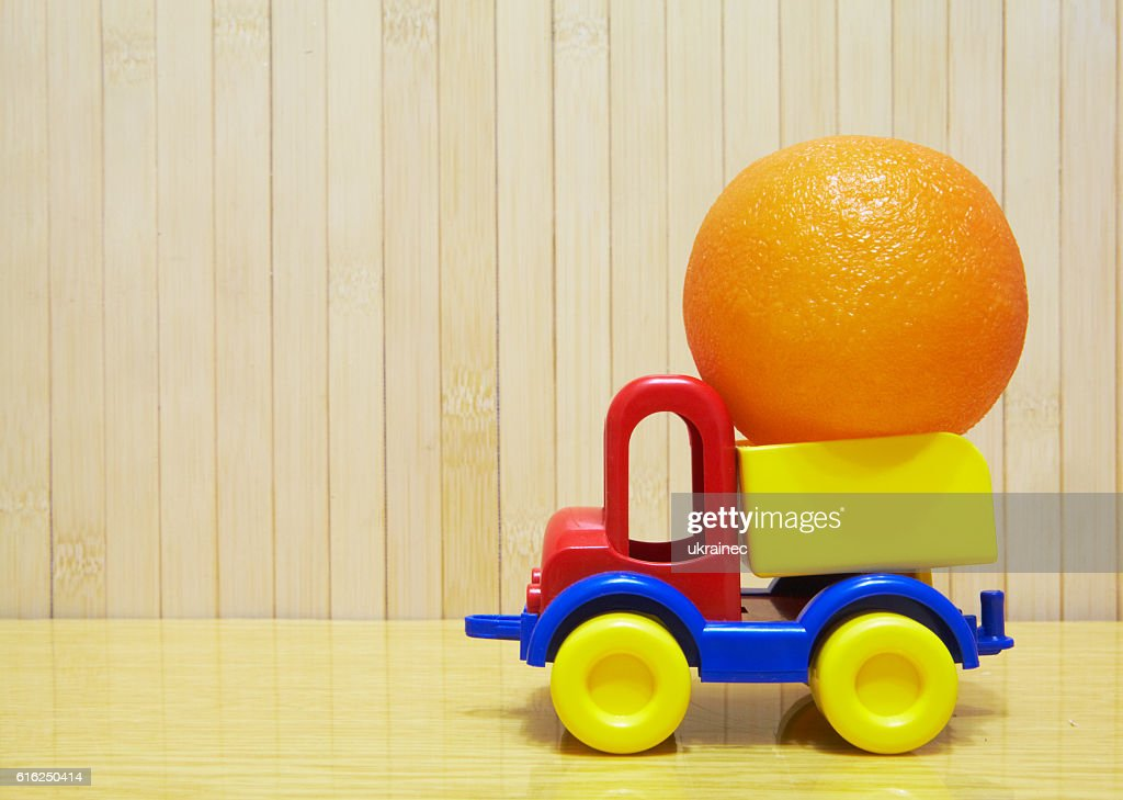 Toy plastic car with orange : Stock-Foto