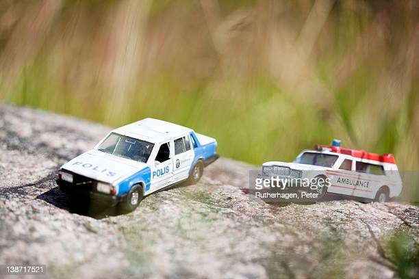 Toy police car and ambulance