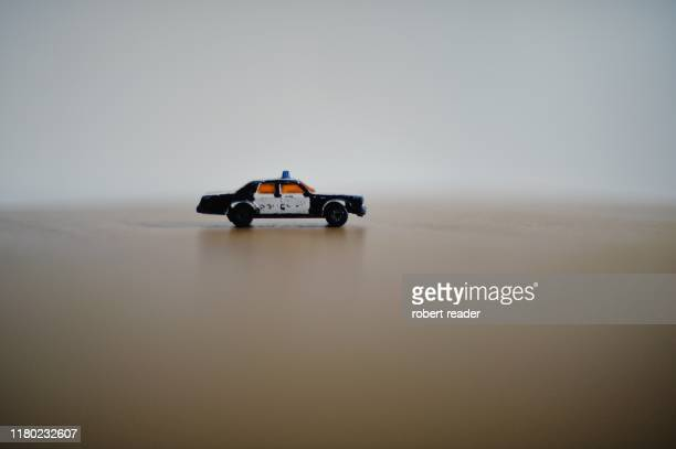 toy police car - law stock pictures, royalty-free photos & images