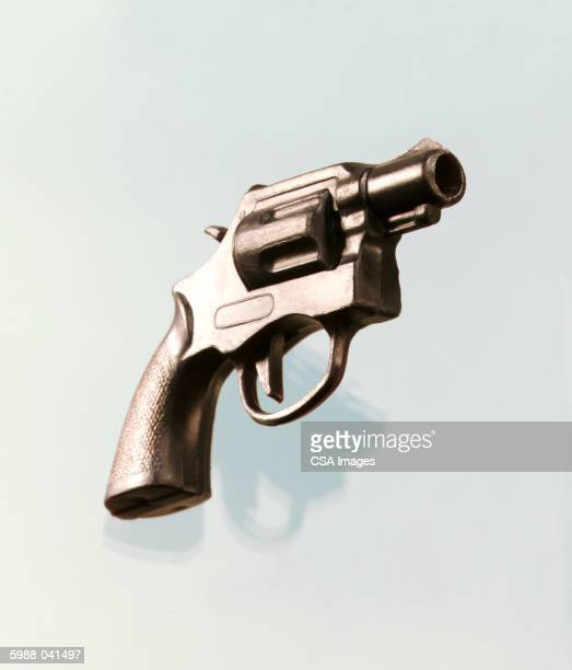 toy revolver - handgun stock pictures, royalty-free photos & images