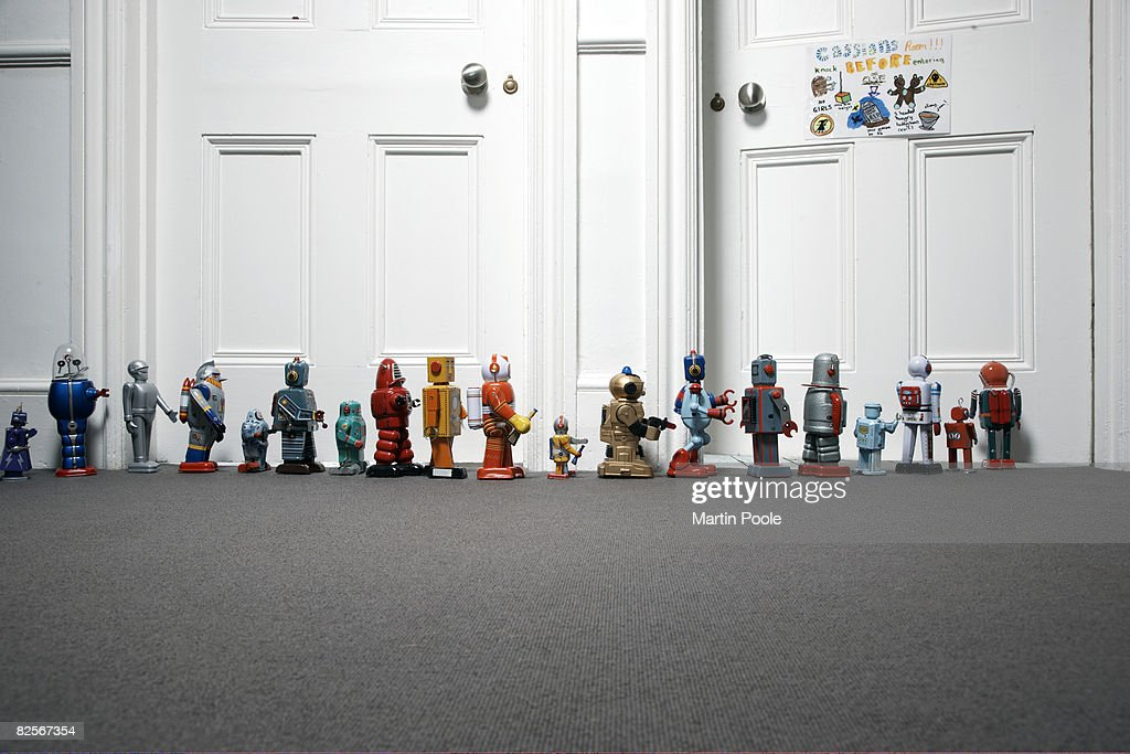 toy robots lined up outside childs bedroom : Stock Photo