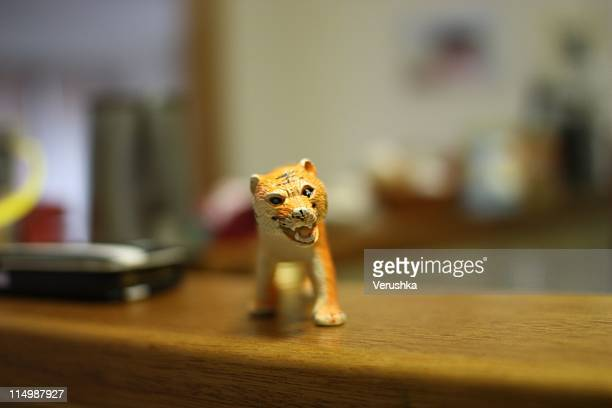 toy sabertooth tiger - toy animal stock photos and pictures