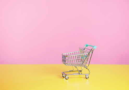 toy shopping trolley with pink  and yellow background - gettyimageskorea