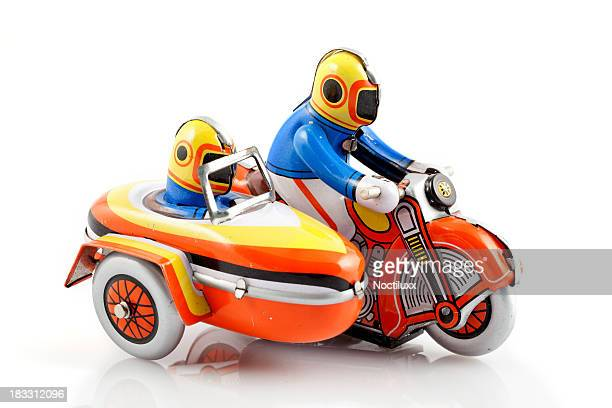 Toy sidecar motorbike with driver and passenger
