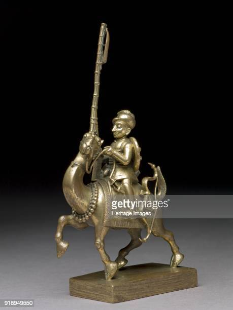 Toy soldier with camel and matchlock 17901795 Armed soldier on prancing camel brass Dimensions height x width x depth 175 x 85 x 44 cm max