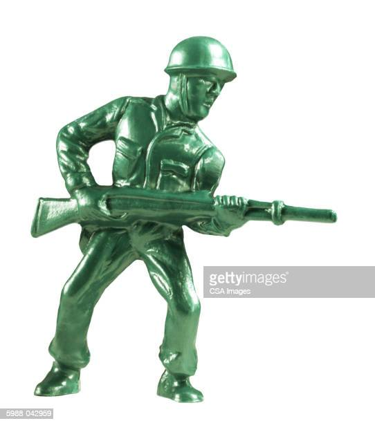 toy soldier with rifle - army soldier toy stock pictures, royalty-free photos & images