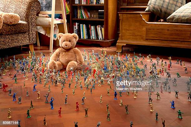 Toy soldiers attacking a toy bear