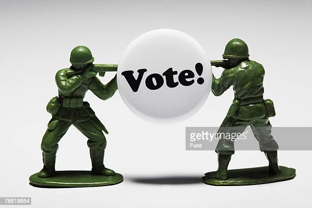 Toy Soldiers Guarding a <Vote!> Button