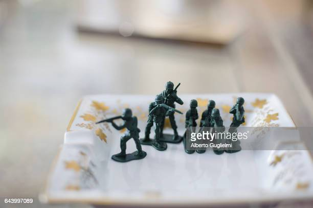 Toy soldiers on antique chair