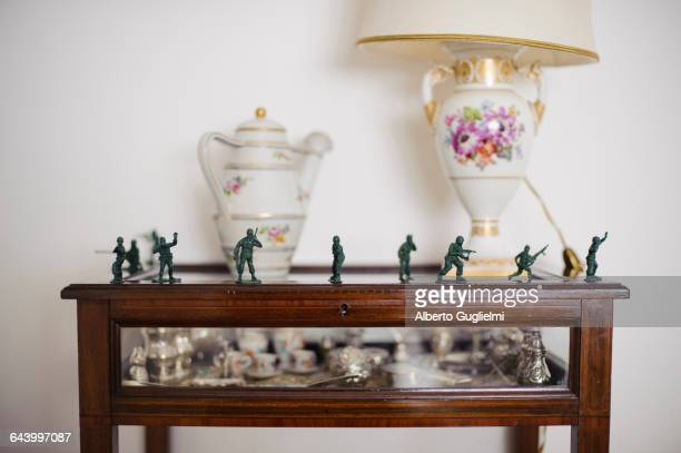 Toy soldiers on antique hutch