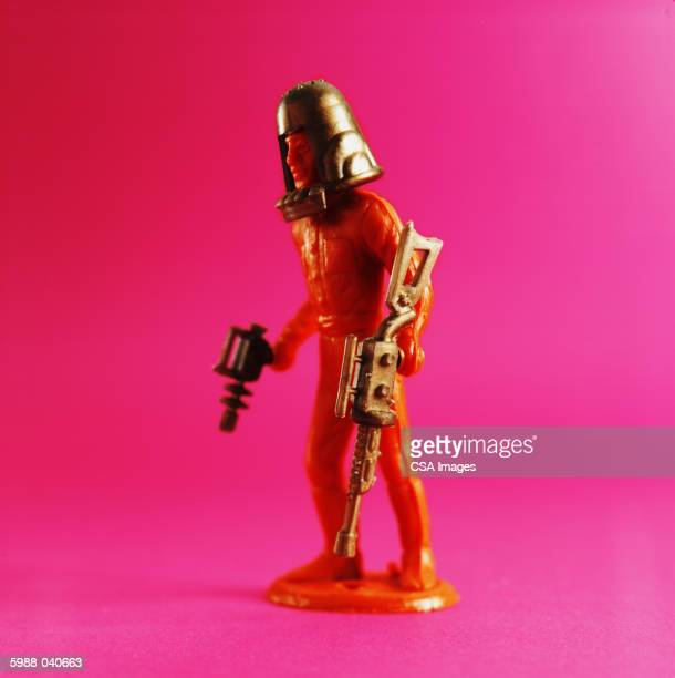 Toy Spaceman Holding Weapons