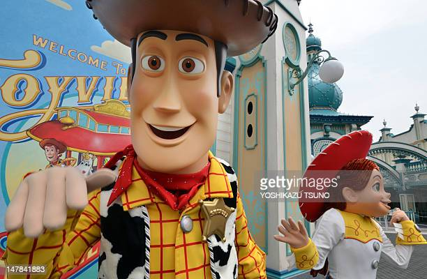 Toy Story characters Woody and Jessie perform at a press preview for the new attraction Toy Story Mania at Tokyo DisneySea in Urayasu suburban Tokyo...