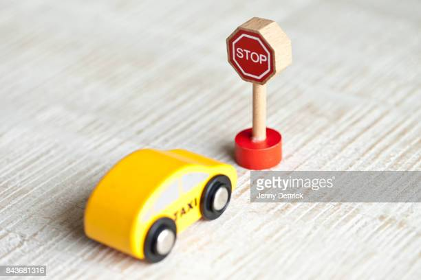 Toy taxi car and stop sign