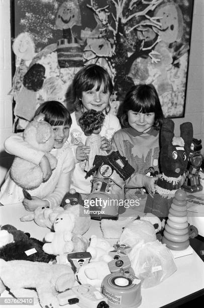 Toy time looking after the toy stall at a Christmas fair held at Almondbury Infants School are Eleanor Chivers five Jennifer Chivers seven and Laura...